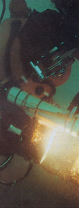 "Diver welding a section of the 32"" pipeline underwater"