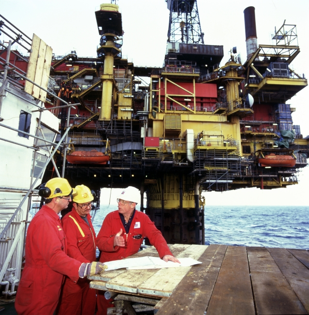 Men working offshore next to a Shell Brent platform